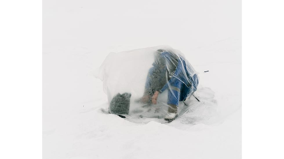 Detroit-based photographer Aleksey Kondratyev, 22, spent two months this winter photographing the fishermen of the frozen Ishim River in Kazakhstan's capital city of Astana. Wrapped in giant plastic bags to shield themselves against frigid winds, these fi