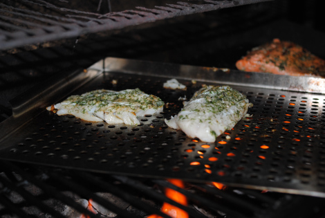 The Grillmaster going to town on grilling cod (low-amine, gluten-free, soy-free, dairy-free, nut-free, paleo).