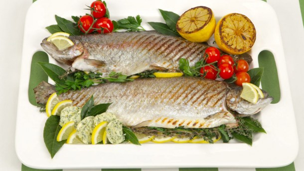 Grilling a whole fish is easy, just remember to grease the grill (not the fish) so the skin doesn't stick to it. Any leftover flavoured butter keeps well for up to a week.