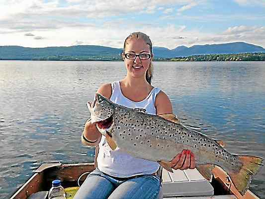 Photo provided In this photo from 2013, Ashley Rose of West Hurley displays a 24-inch, six-pound brown trout she caught in the Ashokan Reservoir