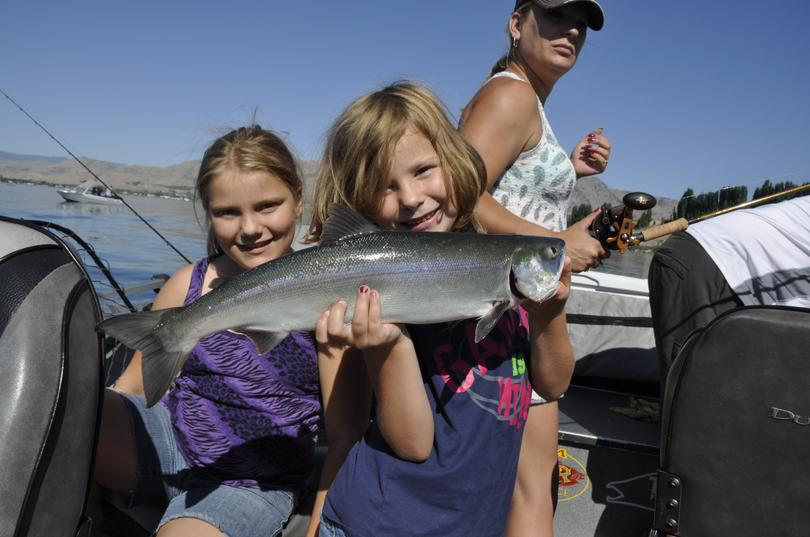 Katlynn, 6, holds a sockeye caught by her sister Mckayla, 10, on a family fishing trip with their father, Omak guide Jerrod Gibbons on the Columbia River near Brewster on July 1, 2015. (Rich Landers)