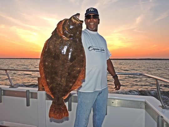 Gary Thompson, Keyport, with a 15-pound 3- ounce fluke caught on the Captain John. (Photo: Capt. John Connell)
