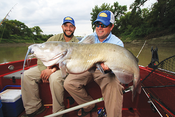 Red River guide Josh Burgett and Jason Mitchell with a giant Red River Channel Cat caught while filming an episode of Jason Mitchell Outdoors TV.